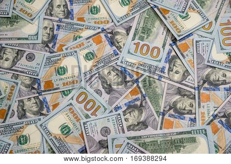 many usa dolalr banknotes as background .