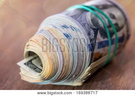 Dollar Roll With Clipping Path On Wooden Background Close Up.