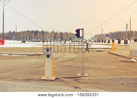Barrier of a airport parking lot. Parking spaces, traffic signal on the riser for cars near the airport.