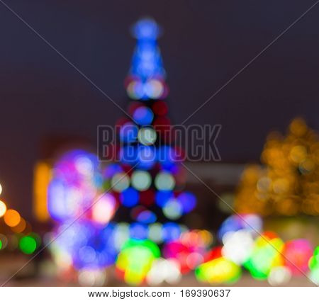 Blurry background - evening illumination with Christmas Tree in center of Dnepr city Ukraine