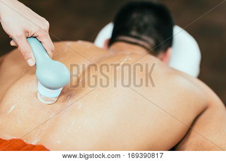 Lower back ultrasound therapy, close up, toned image