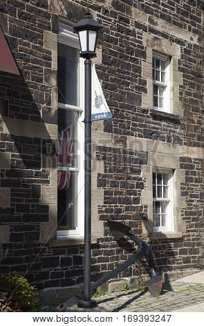 The lamppost and the anchor next to the historic building in Halifax old town (Nova Scotia).