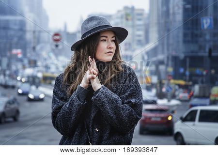 Brown haired girl walking around city, in cloudy day, outdoor