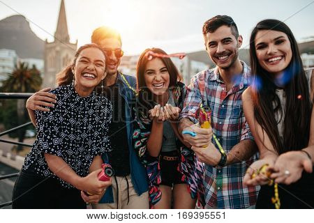 Friends Hanging Out Together On Rooftop Party