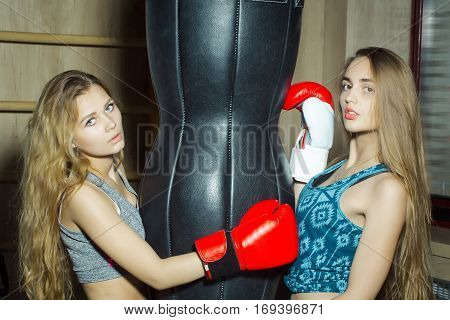 Two Pretty Girls Boxers Punching