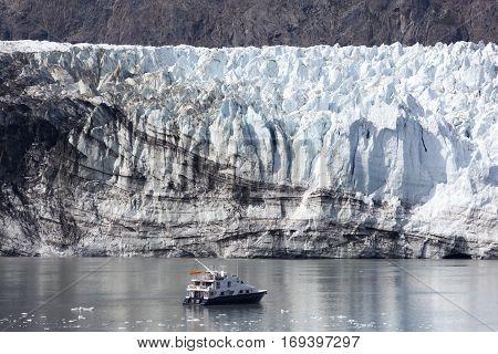The little boat exploring the glacier in Glacier Bay national park (Alaska).