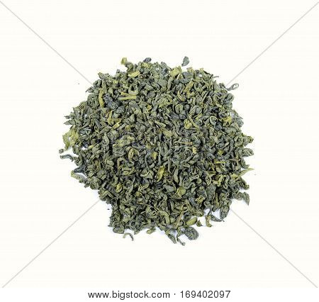 dried green tea leaves on white, top view