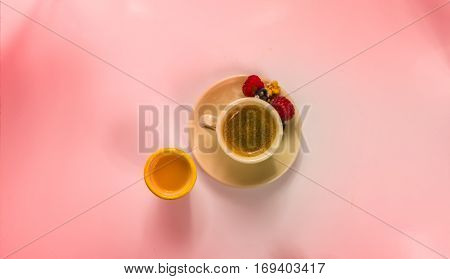 Black coffee in a cup of cream with rasberry and orange juice sweet set