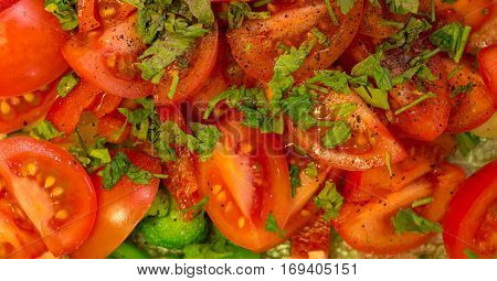 Salad of cherry tomatoes with parsley, broccoli and black pepper. Close-up.