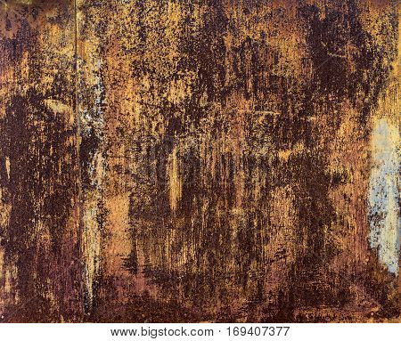 Rusted metal surface with paint residues. texture