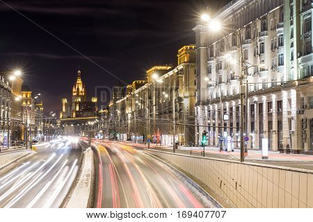 Triumph Square and transport metropolis, traffic and blurry lights of cars on multi-lane highways and road junction at night in Moscow