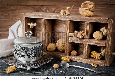 Still life with a wooden box and nuts. Horizontal image