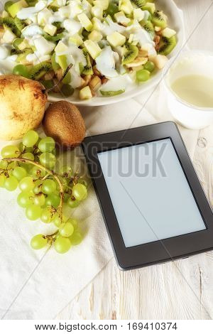 fruit salad and ebook on white boards