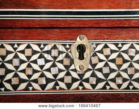 keyhole in an old patterned casket closeup