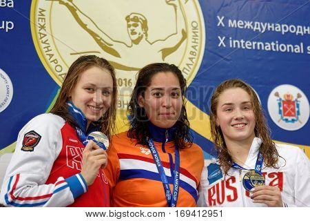 ST. PETERSBURG, RUSSIA - DECEMBER 16, 2016: Winners of X Salnikov Cup in 100 m freestyle swimming Ranomi Kromowidjojo of Netherlands (center), Veronika Popova (left) and Daria Kartashova of Russia