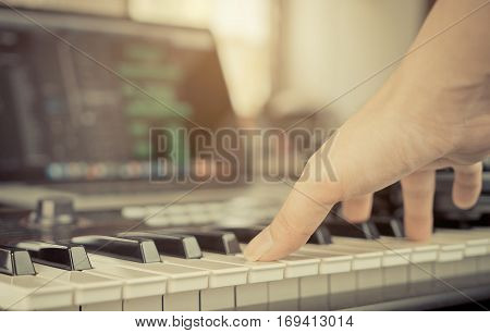Muscian hand playing Keyboard in home studio