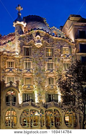 Evening photo of the Batllo House, a  museum in Barcelona, Spain. Designed by Antoni Gaudi.
