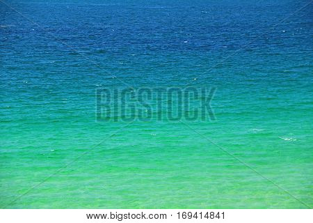 Background: green and blue water on the coast of Brittany