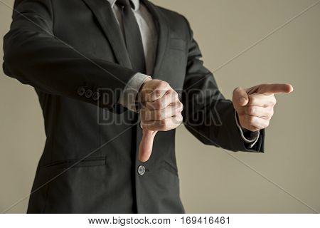 Businessman Giving A Thumbs Down Negative Vote