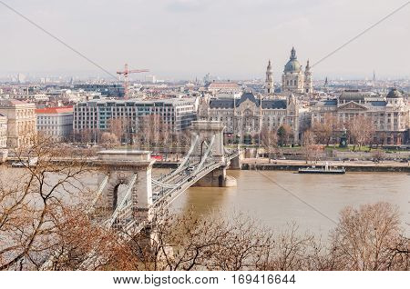 View Of The Szechenyi Chain Bridge And Church St. Stephen's In Budapest