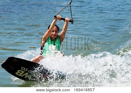 Sports girl goes in for sports in the sea kiteboarding
