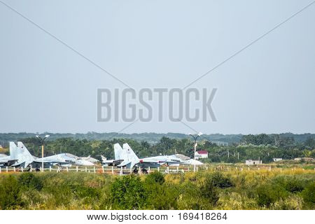 Military Airfield And Parking Lots Of Planes.