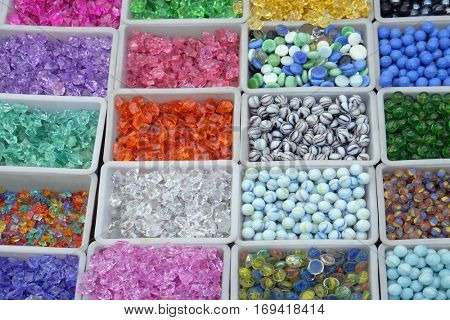 Multi colored beads and tools for making jewelry and crafts