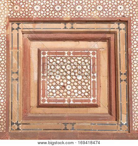 FATEHPUR SIKRI, INDIA - FEBRUARY 15: Beautiful stone carvings on the wall in Fatehpur Sikri complex, Uttar Pradesh, India on February 15, 2016.