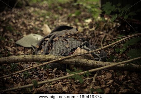 Teenager Dead Body Covered With Leaves
