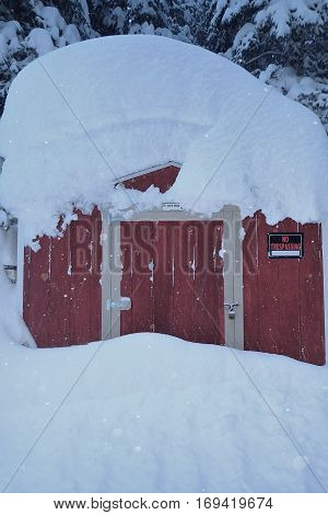 Red Shed Buried under Feet of Snow