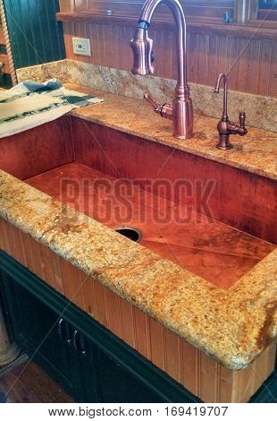Huge Copper Sink with Faucets trimmed with Granite
