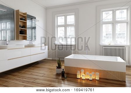 Group of burning candles on the wooden floor alongside the bathtub in a spacious bright white bathroom with large windows and wall-mounted vanities, 3d rendering