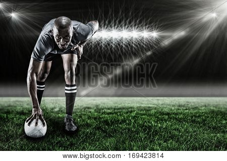 Portrait of rugby player smiling against spotlight and copy space 3d