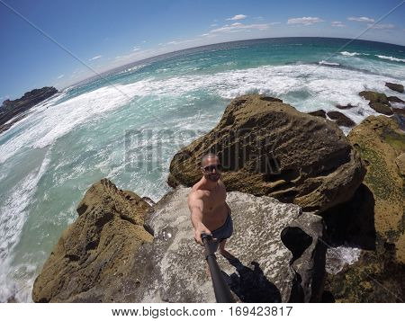 Man taking a selfie in a beach in Sydney, Australia - GoPro Camera