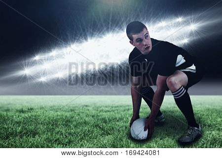 Rugby player about to throw a rugby ball against spotlights and copy space 3d