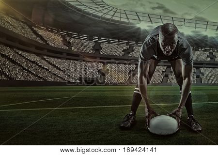 Portrait of sportsman holding ball while playing rugby against rugby stadium with copy space 3d