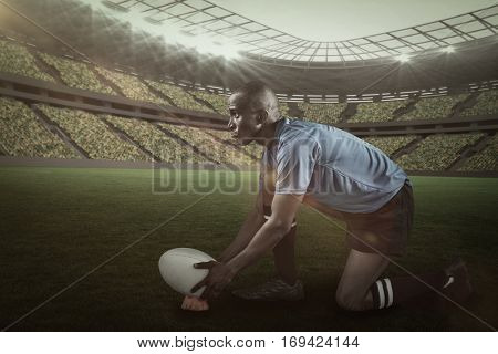 Confident rugby player looking away while keeping ball on kicking tee against rugby stadium with copy space 3d