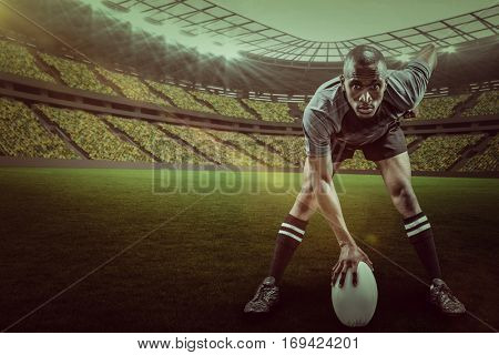 Portrait of sportsman playing rugby against rugby stadium with copy space 3d