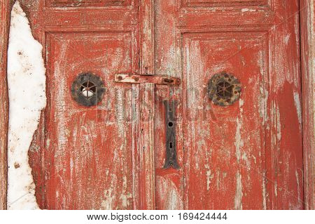Mysterious Snowy Old Wooden Red Door. Mysterious Entrance To The House.