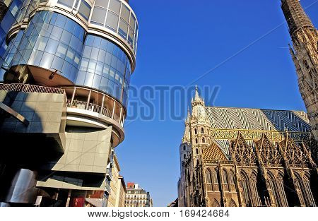 Famous gothic cathedral St. Stephens and new building in the center of Vienna(Austria)