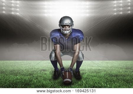 American football player with ball crouching against spotlight with copy space 3d