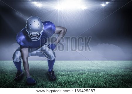 American football player in uniform bending against spotlight with copy space 3d