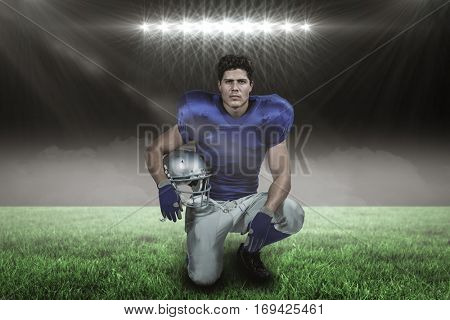 Portrait of confident American football player holding helmet against spotlight with copy space 3d