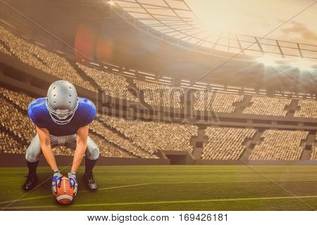 American football player placing ball against large football stadium with lights with copy space 3d