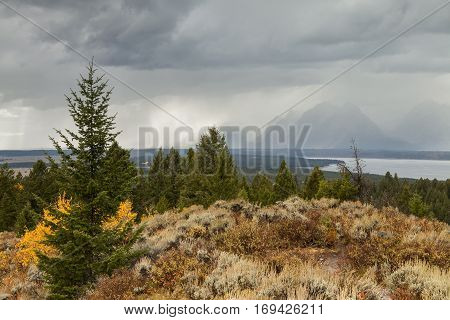 The storm clouds shroud the mountains in mist
