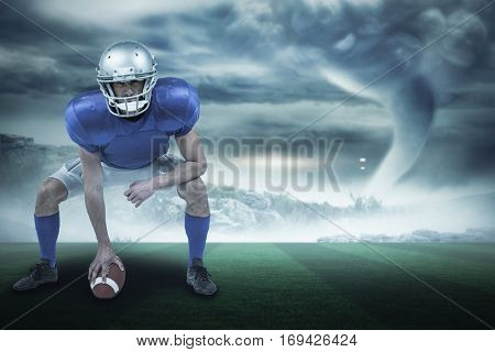 Full length of American football player placing ball against stormy sky with tornado over landscape with copy space 3d