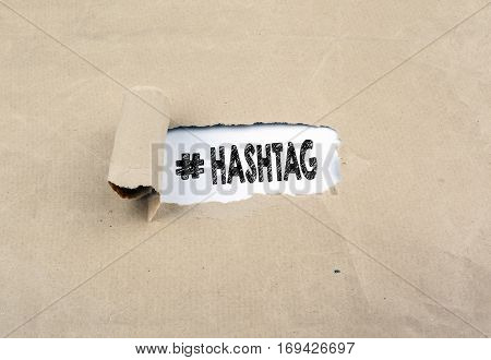 Inscription revealed on old paper - Hashtag. Background with texture