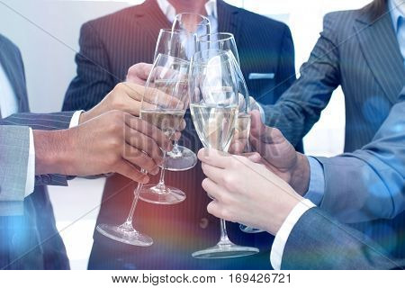 Close up of business team toasting with Champagne in the office