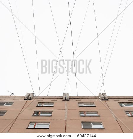 Typical block of flats conected with multiple wires in the sky