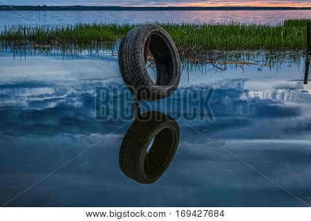 the second life of an automobile tire as the soft mooring for fishing boats